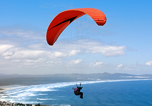Paragliding Over the Ocean